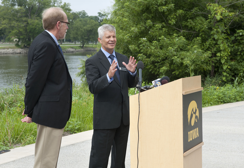 U.S. Representative Dave Loebsack (left) and IFC Director Witold Krajewski discuss the proposed national flood center at a press conference in Iowa City on August 6, 2013.