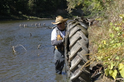 Dan Ceynar removes a tire from the river.